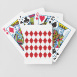 Red ornaments on white bicycle playing cards