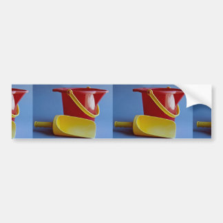Red pail and yellow scoop car bumper sticker