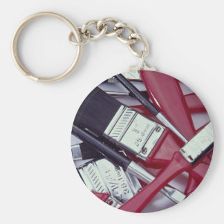 Red paint brushes key chains