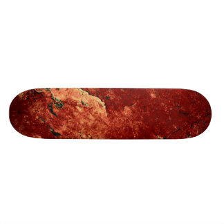 Red Painted Rock Skateboard