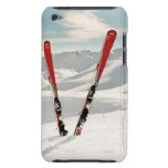 Red pair of ski standing in snow barely there iPod case