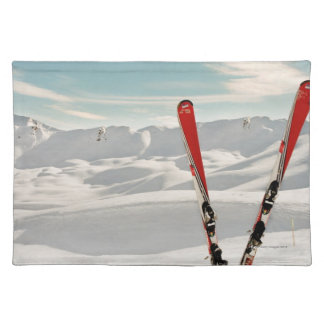 Red pair of ski standing in snow cloth place mat