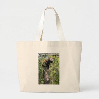Red panda eating leaves large tote bag