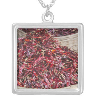 Red peppers at local produce market silver plated necklace