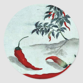 Red peppers with plant growing in the background U Classic Round Sticker