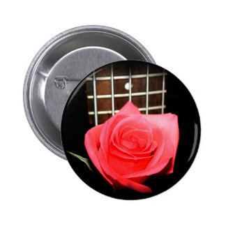 Red pink rose against five string bass fret board 2 inch round button