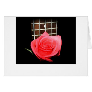 Red pink rose against five string bass fret board card