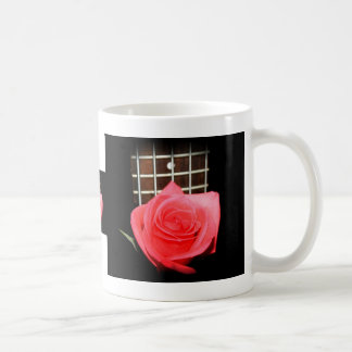 Red pink rose against five string bass fret board coffee mug