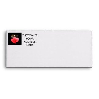 Red pink rose against five string bass fret board envelope