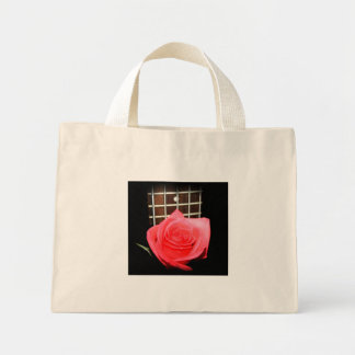 Red pink rose against five string bass fret board mini tote bag
