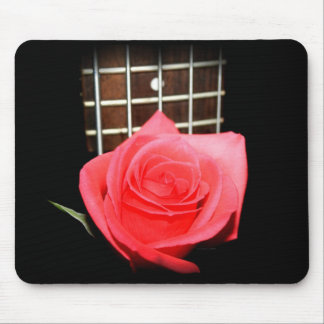 Red pink rose against five string bass fret board mouse pad