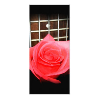 Red pink rose against five string bass fret board rack card