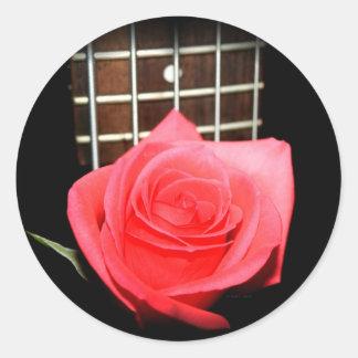 Red pink rose against five string bass fretboard round sticker