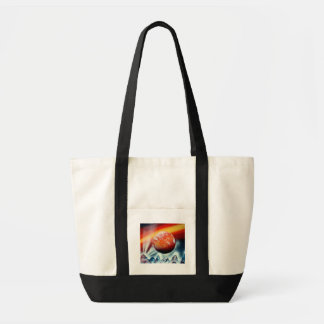 Red planet over mountains with backlighting tote bag