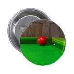 Red pool ball on pool table button
