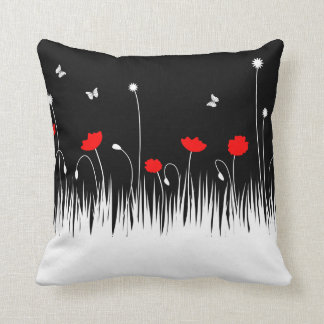 Red poppies black background throw pillow