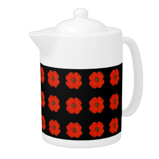Red poppies on a black matt background teapot