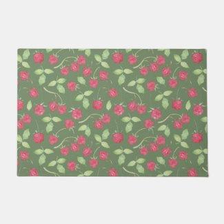 Red Raspberries on Green Floor Mat