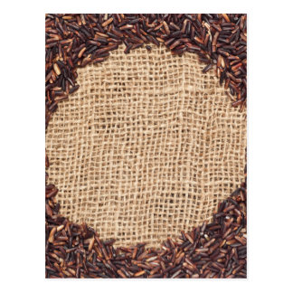 Red rice on burlap fabric postcard