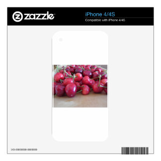 Red ripe cherries on wooden tray skin for iPhone 4