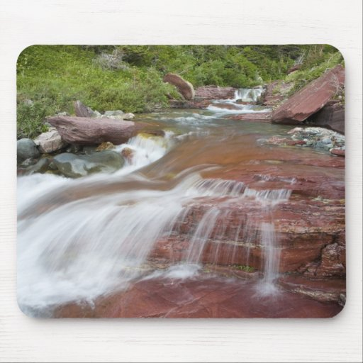 Red rock in Baring Creek in Glacier National Mousepad