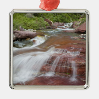 Red rock in Baring Creek in Glacier National Christmas Ornaments