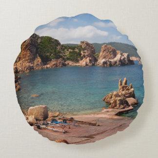 Red rocky coast of Sardinia round pillow