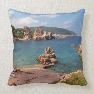 Red rocky coast of Sardinia throw pillow