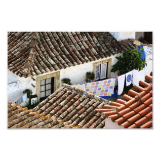 Red roofs and hanging clothes in mediterranean photo print