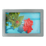 red rose against blue plastic wrap style belt buckle