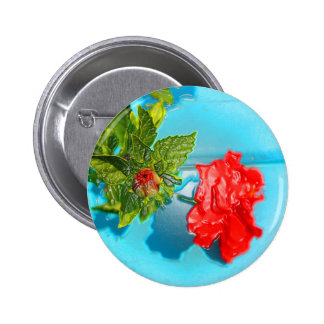 red rose against blue plastic wrap style pin
