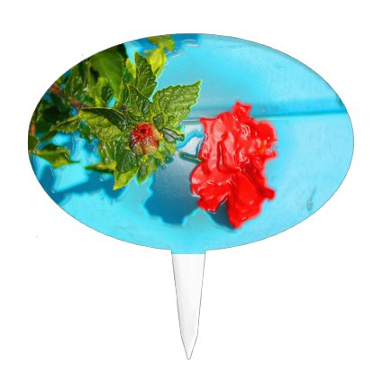 red rose against blue plastic wrap style cake toppers