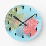 red rose against blue plastic wrap style round wall clocks