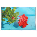red rose against blue plastic wrap style placemat