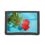 red rose against blue plastic wrap style tri-fold wallet
