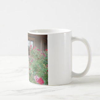Red Roses and a reflection of the Mts. in windows Coffee Mug