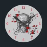"""Red Roses Skull Wall Clock<br><div class=""""desc"""">Black and white sketch of a skull with beautiful red roses and black swirls all around it. This would make an awesome addition to your game room,  or college dorm room or anywhere in the house!</div>"""