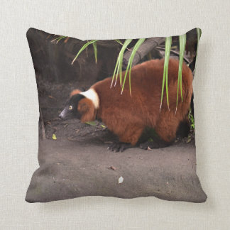 red ruffed lemur walking left w frond  animal pillow