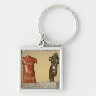 Red sandstone male torso and grey sandstone dancer key chains