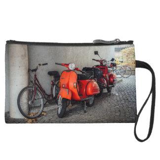 Red scooters in Berlin Suede Wristlet