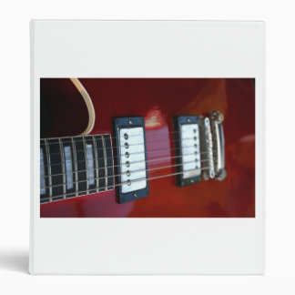 Red semi hollow guitar picture of strings, pickups 3 ring binder