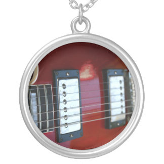 Red semi hollow guitar picture of strings, pickups jewelry