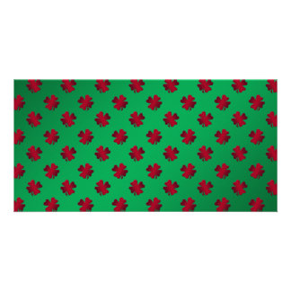 Red shamrocks on green background photo card template