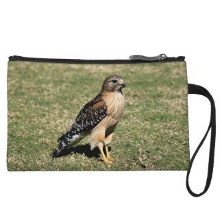 Red Shouldered Hawk on Golf Course Wristlet Clutches