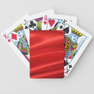 Red silk background bicycle playing cards