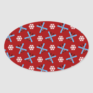 red skis and snowflakes pattern oval sticker