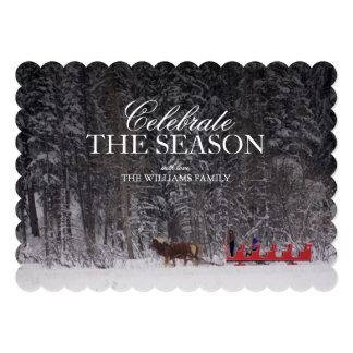 Red Sleigh ride near snow covered forest. Card