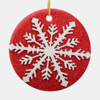 Red snowflake on a red glitter background ceramic ornament