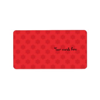 Red snowflake pattern on red address label