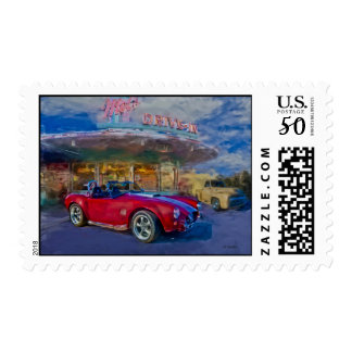 red sports car at drive-in postage